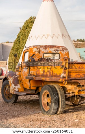 December 21, 2014 - Wigwam Hotel, Holbrook, AZ, USA: time period vehicles parked in front of the historic hotel