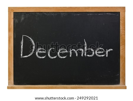 December written in white chalk on a black wood framed chalkboard isolated on white - stock photo