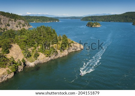 Deception Pass State Park, Washington .Rugged cliffs drop to meet the turbulent waters of Deception Pass. The park is known for its breath-taking views, old-growth forests, and abundant wildlife. - stock photo