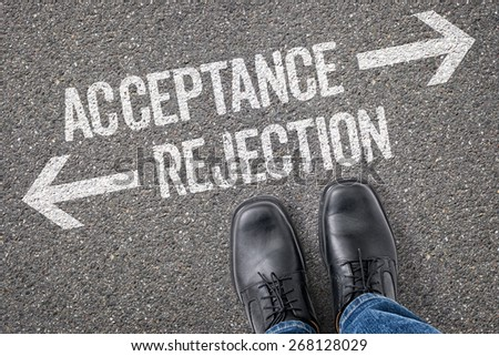 Decision at a crossroad - Acceptance or Rejection - stock photo