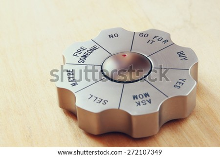 decision maker toy set to the words go for it. business and and decision making concept. image is retro filtered - stock photo