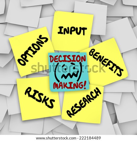 Decision Making words on sticky notes surrounded by things to consider such as options, input, research, risks and benefits - stock photo
