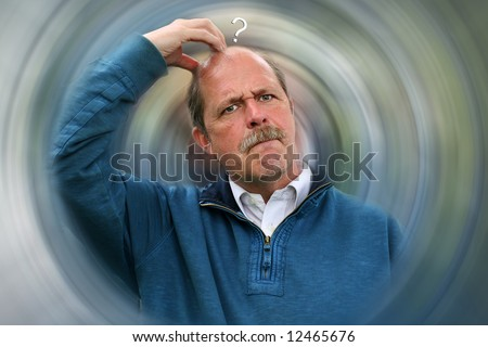 Decisions to be made vortex concept with Puzzled Man scratching head - stock photo