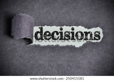 decisions  word under torn black sugar paper  - stock photo