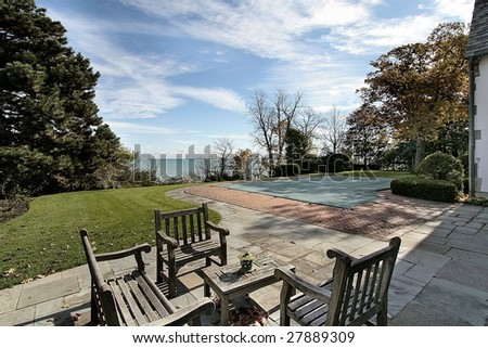 Deck and pool with lake view - stock photo