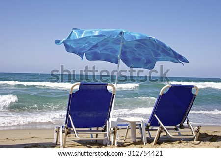 Deck chair on the beach. Stormy sea.