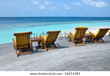 deck chairs at the ocean in front of turquoise sea