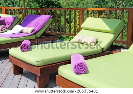 deck chairs by the pool - stock photo