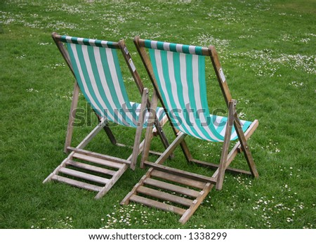 Deck chairs from rear in park - stock photo