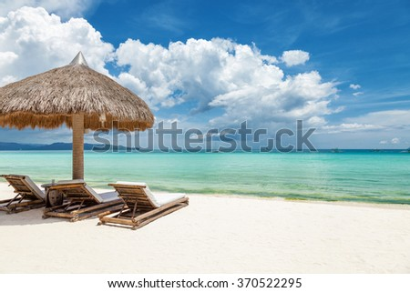 Deck chairs on a beautiful beach in Boracay, Philippines