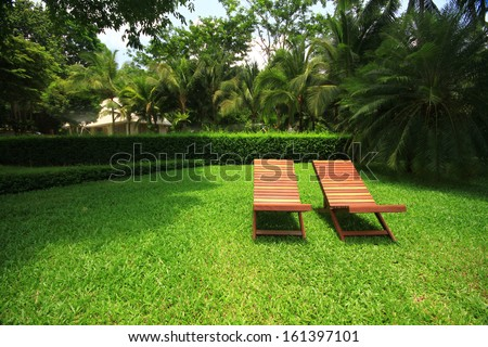 Deck chairs on green grass  - stock photo
