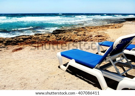 deck chairs on the beach - stock photo