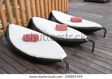 Deck chairs on the terrace of a luxury - stock photo