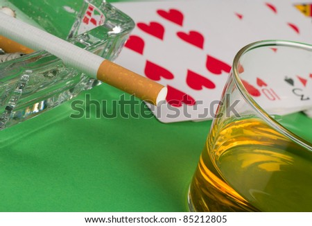 Deck of cards, smoke and whiskey, gambling still life
