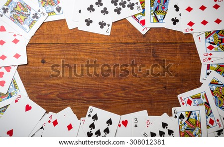 Deck of cards used as a border. - stock photo