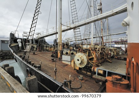 deck of old ship in harbor