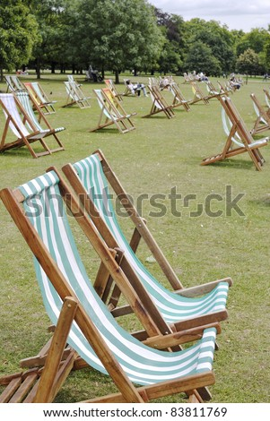 Deckchairs for hire in Hyde Park. Westminster. London. England - stock photo