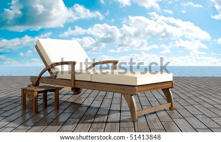 deckchairs in front of sea in summer day
