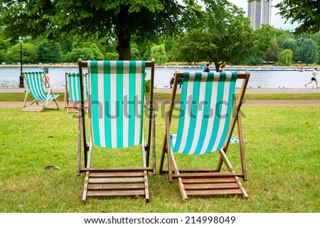 Deckchairs in Hyde Park. London, England, UK - stock photo