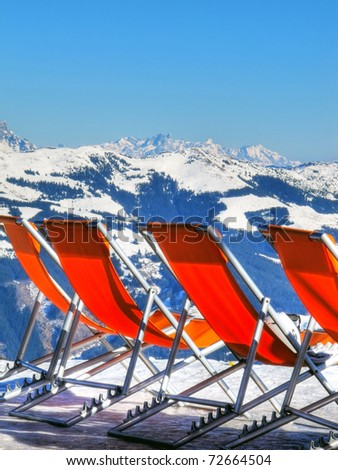 Deckchairs in ski resort, Austria, Zell Am See - stock photo