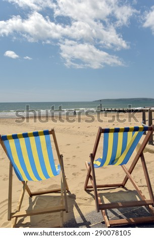 Deckchairs on beach at Bournemouth, Dorset