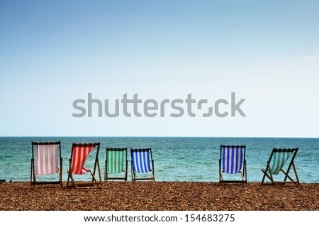 Deckchairs on Brighton Beach - stock photo