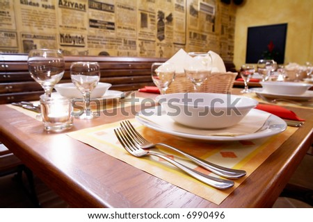 decked table in restaurant, interior - stock photo