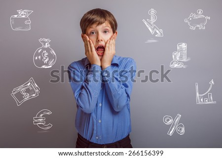 decline in the US dollar money crisis surprise teenager boy opened his mouth on blue background - stock photo