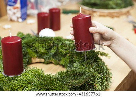 Decorate an advent wreath with candle - stock photo