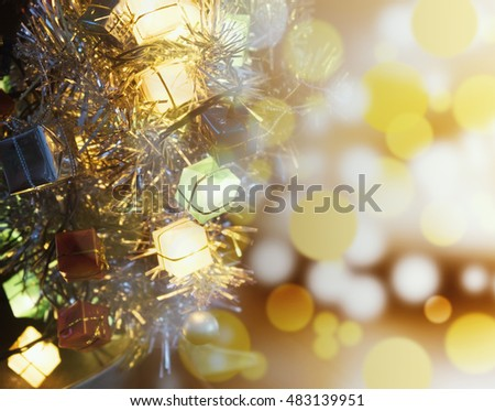 Decorate christmas tree with blur light or bokeh.
