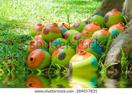 Decorate colorful jar under the tree  - stock photo