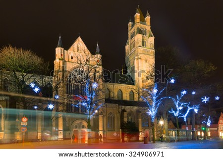 Decorated and illuminated Christmas street near Sint-Salvator Cathedral in Bruges, Flanders, Belgium - stock photo