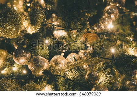 Decorated and illuminated christmas tree, vintage toning - stock photo