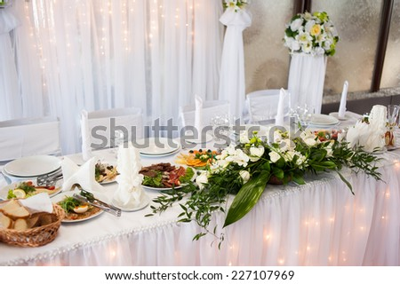 Decorated and served bride and groom's wedding table - stock photo