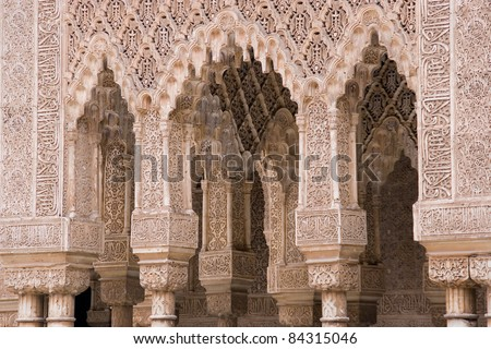 "Decorated arches in the ""Patio of the lions"" inside the Alhambra Palace (in Granada, Spain) - stock photo"
