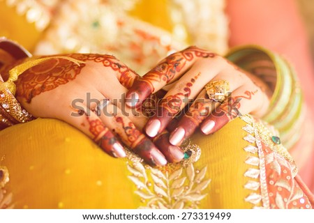 decorated bridal hands with henna - stock photo