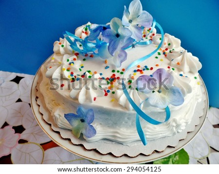 Decorated cake with white icing - stock photo