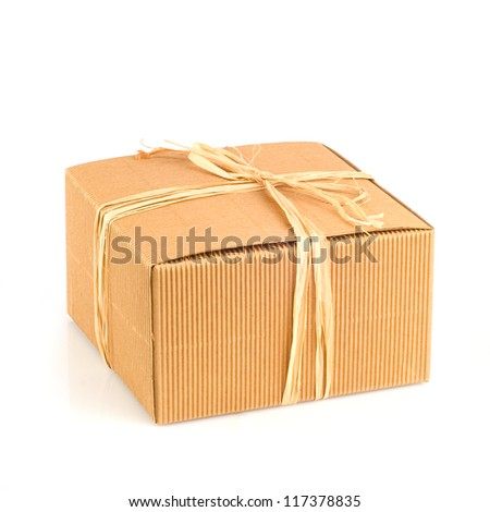 Decorated cardboard box on a white background. - stock photo