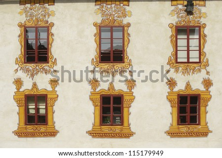 Decorated castle windows on a castle in Slovenia - stock photo