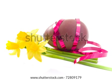 decorated chocolate easter egg on white background