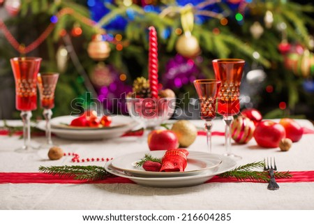decorated christmas dining table christmas tree in background - stock photo