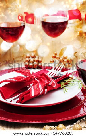 Decorated Christmas Dinner Table with Red Wine - stock photo