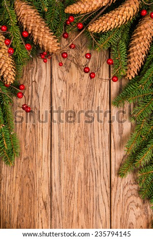 Decorated Christmas fir tree on a wooden board - stock photo