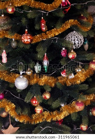 Decorated Christmas fir tree with garland and balls - stock photo