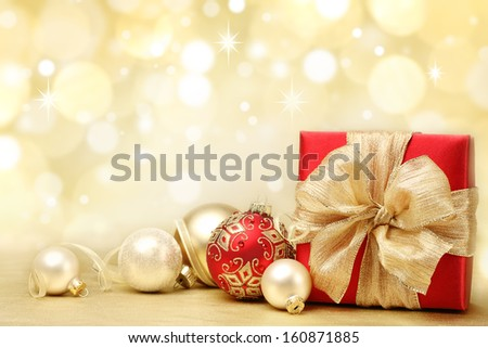 Decorated Christmas gifts on abstract background - stock photo