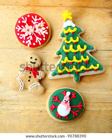 Decorated christmas gingerbreads on wooden background - stock photo