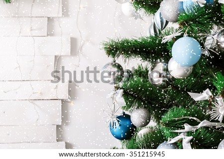 Decorated Christmas tree. Beautiful living room with  snow - stock photo