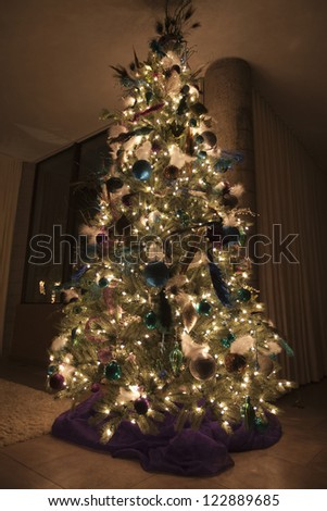 Decorated Christmas tree in house