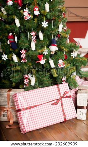 Decorated Christmas tree in red and white colors - stock photo
