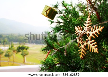 Decorated Christmas tree on a natural background.